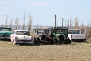 A Ford cars and other oldtimers along the road