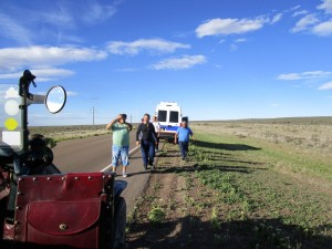 Men stopping for the car